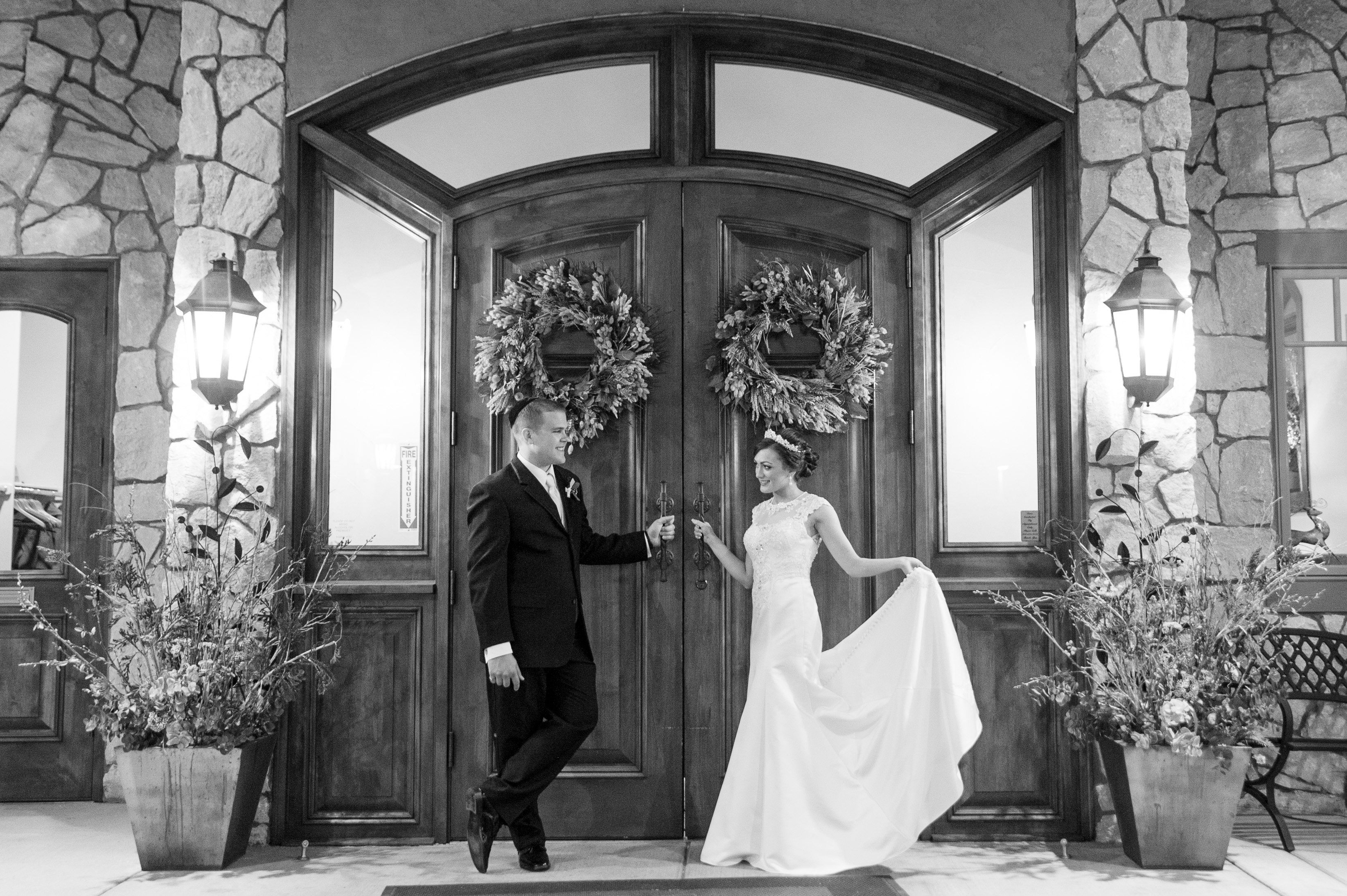 bride and groom outside the doors at cielo at castle pines venue