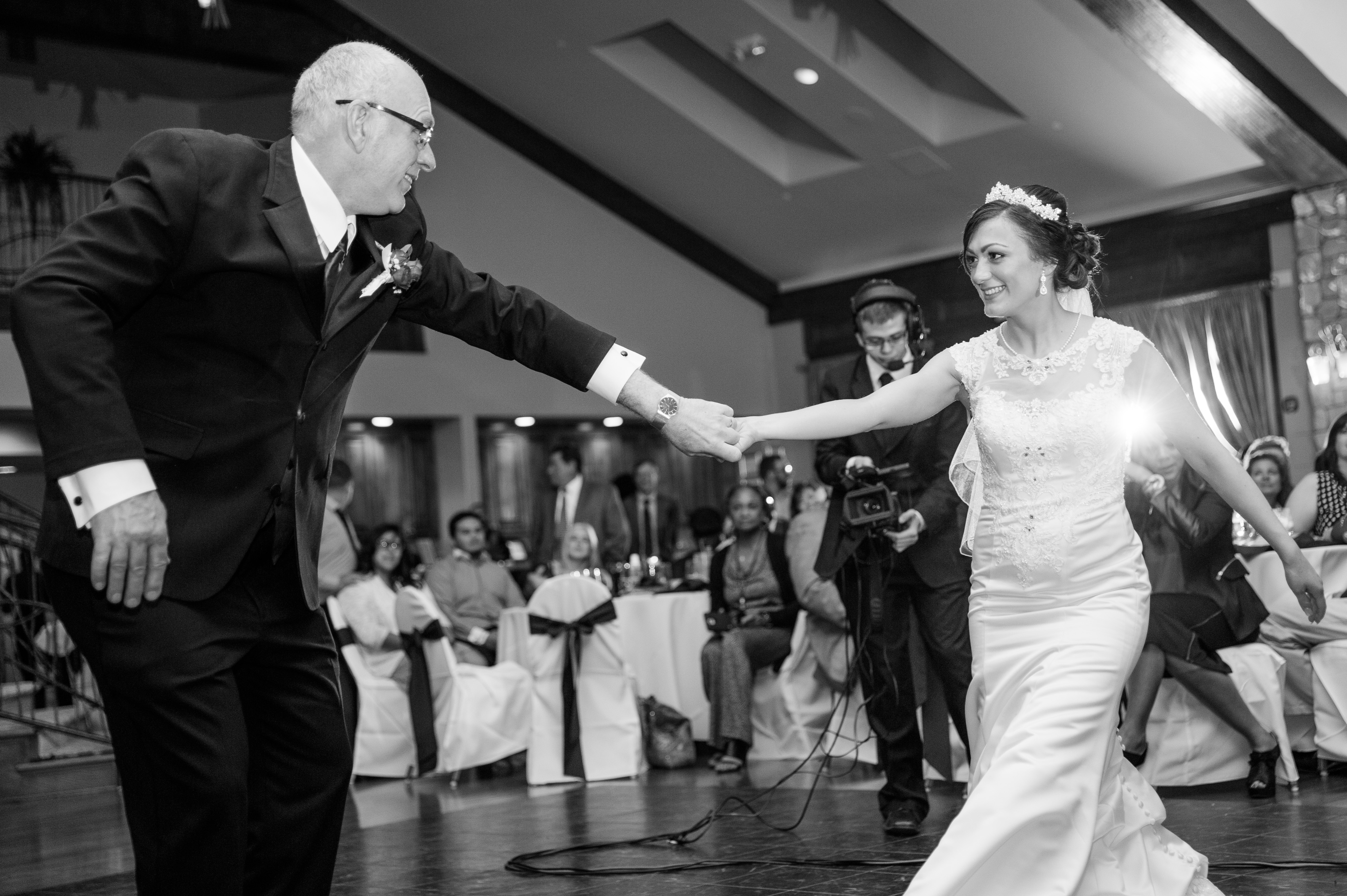 father and bride dancing at reception