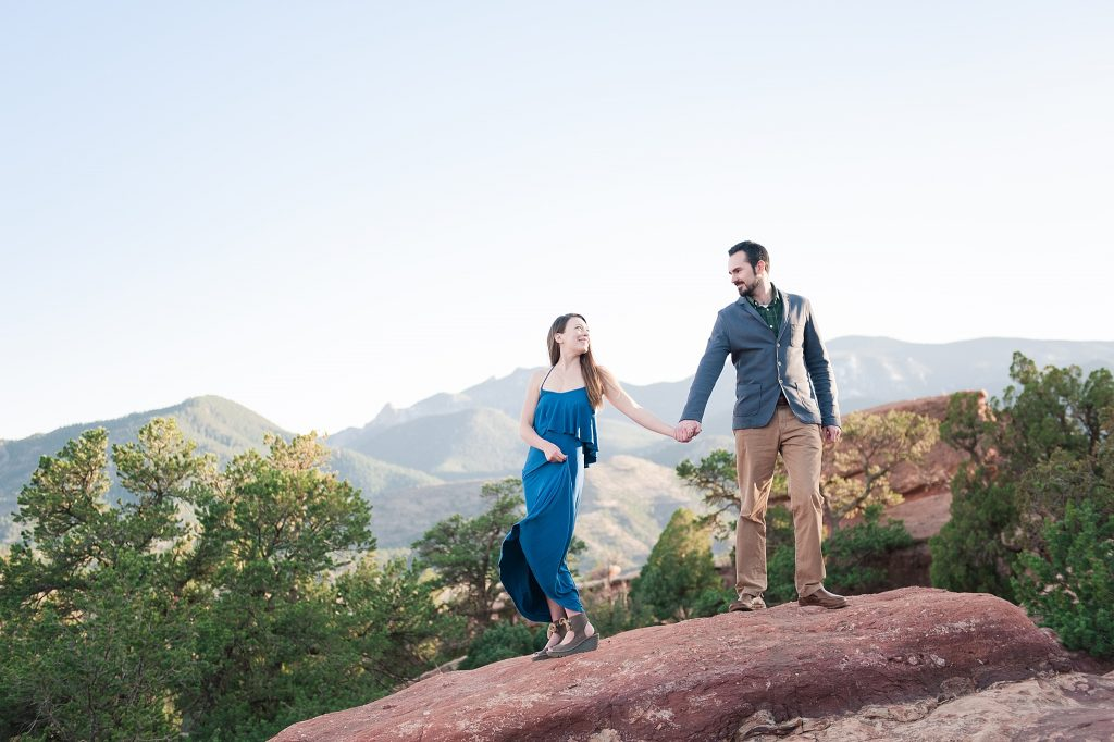 couple standing on red rocks
